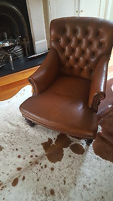 Antique Leather Grandmother Chair with scroll back