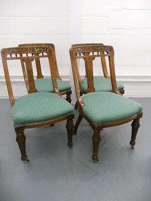 Victorian antique oak dining chairs with casters and carving detail