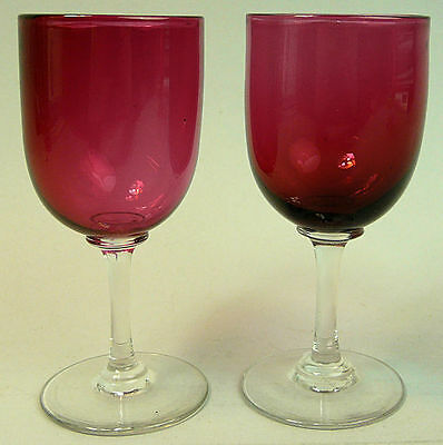A Fine Pair Of Victorian Hand Blown Cranberry Wine Glasses C.1890