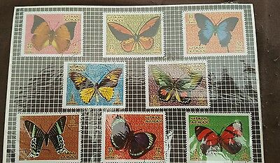 A set of used butterfly stamps from AJMAN