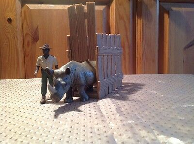 Lot 98 - Authentic Schleich Rhino being Transported in Cage with Gamekeeper