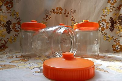 Vintage/Retro Set of Four, Glass Canisters with Orange Lids