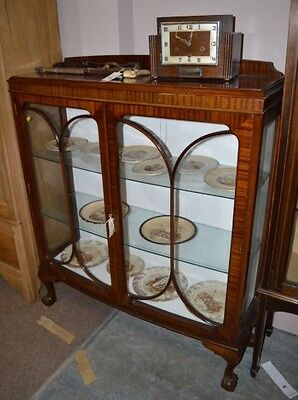 An early 20th Century bowfront display cabinet