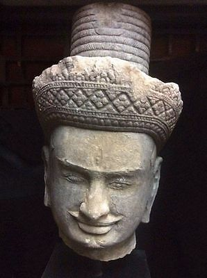 KHMER SANDSTONE HEAD OF A MALE DEITY, ANGKOR PERIOD, PREAH KO STYLE, 10/12th C.