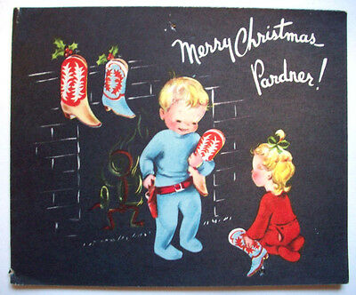 Boy hangs cowboy boots for stockings Christmas vintage greeting card *I