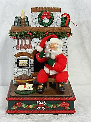 Santa by Fire Place Holiday Creations Music Medley Christmas Candle with Light