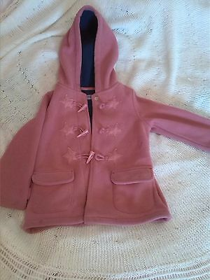 Hot pink fleece jacket with dark blue lining age 3-4  with star décor on front