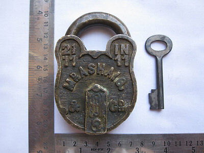 031 An old solid brass padlock or lock with key collectible carving