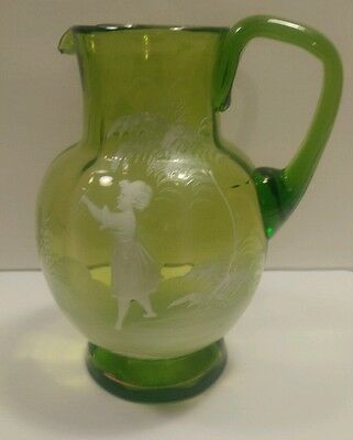 "Mary gregory green glass water pitcher. 7"" tall."