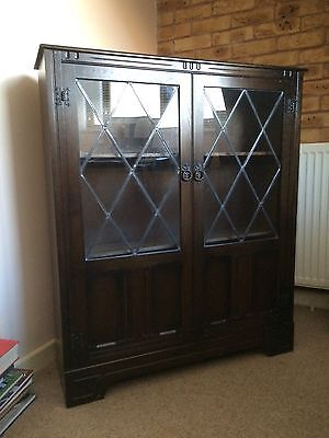 Bookcase carved dark Wood With Leaded Glass Doors
