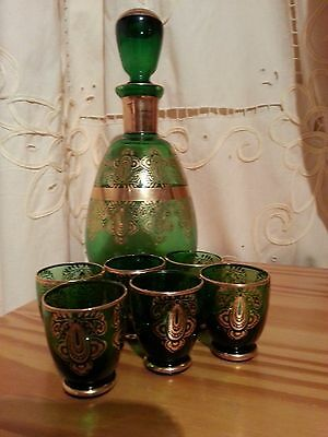 green glass decanter and 6 little glasses