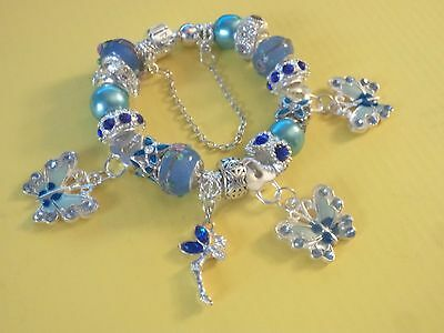 Girls Ladies European Charm Bracelet With Blue Crystal Butterfly & Fairy Charms.