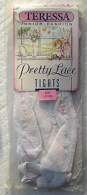New (ex shop stock) childs lace tights  1-2 yr  white with some other colours