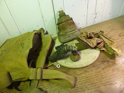 Antique vintage French military gas mask in canvas bag dated 1935