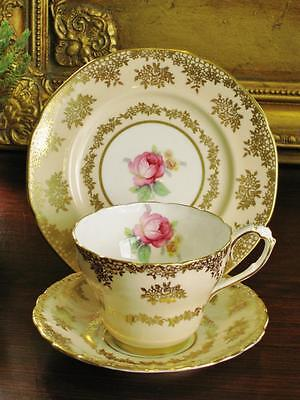 Stunning vintage Paragon England trio, floral with gold decoration. High tea