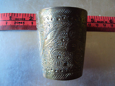Brass small pot with dogs designs similar to a thimble