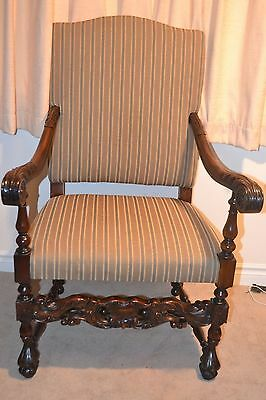 Restored and reupholstered antique throne armchair in good condition