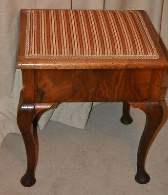 Reupholstered antique piano stool with storage in very good condition