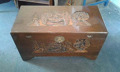 Chinese Heavily Laquered Carved Camfer Wood Chest