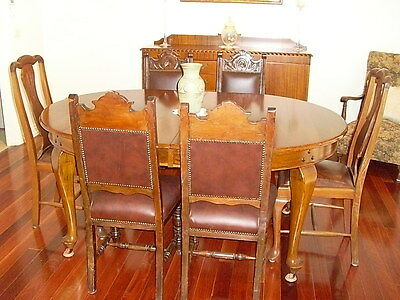 antique dining table and 6 chairs.