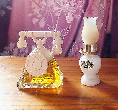 "Two Vintage Avon perfume bottle Small Telephone "" Timeless "" and oil lamp Empty"