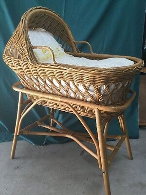 Authentic vintage cane wicker bassinette on stand with mattresses and linen