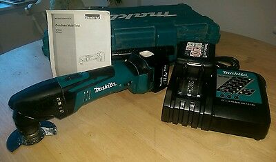 Makita 14.4v multi tool BTM40RFX3. 2X genuine batteries. Insured postage