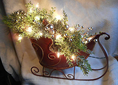 "17"" long Winter Christmas Lighted Metal Sleigh with Pine ornaments arrangement"