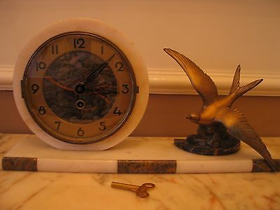 french art deco clock with spelter figure of swooping bird