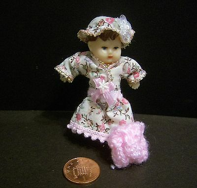 Miniature 1/12th scale dolls house dressed Baby Doll.