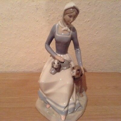 Spanish porcelain figure of Woman with Dog and Puppy.