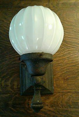 Vintage arts & crafts style cast iron porch sconce light. Milk glass globe