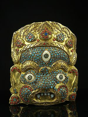 An Antique Nepali (Nepalese) Bejewelled Gilt Metal Face Mask.