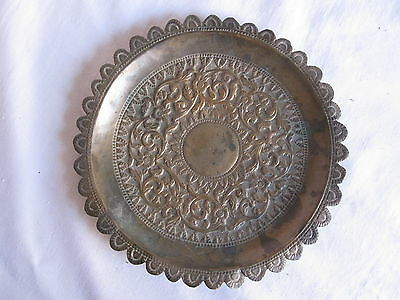 An old or antique brass plate mughal style carving of flower patterns.
