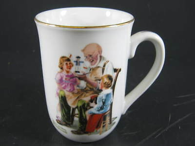 vintage Norman Rockwell The Toymaker white porcelain cup with gold gilt 1982