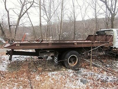 20' steel rollback body for car hauling with T bar by Cambridge on 1983 Ford