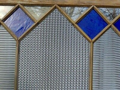 Antique window with blue stained glass and clear textured rippled privacy glass