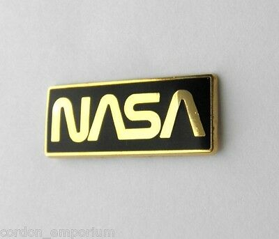 US NASA BLACK AND GOLD COLOR LOGO SPACE AGENCY LAPEL PIN BADGE 1.25 x 1/2 INCHES