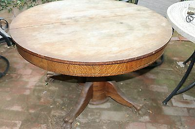 Antique claw dining table and chairs