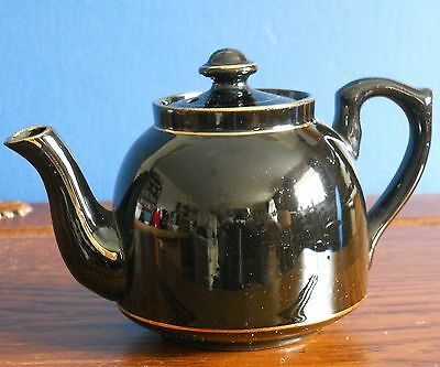 A Small Antique Jackfield style High Gloss black with Gilt Teapot