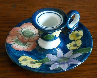 A Hand decorated Candlestick holder