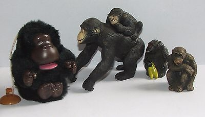 A collection of 4 chimp / monkey ornaments / novelties