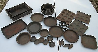 collection of vintage old rusty cake baking cooking roasting tins for display