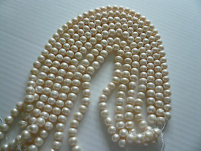 STRING OF 8mm x 10mm FRESHWATER PEARLS APPROX 44-46 PEARLS PER STRING