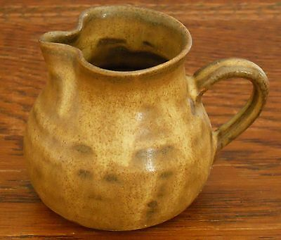 A hand made little brown Prinknash Jug
