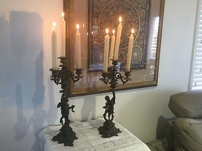 Genuine French bronze antique cherub candlestick holders matched pair rare desir