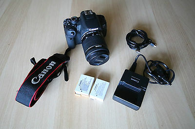 Canon EOS 700D 18.0 MP Digital SLR Camera(with 18-55 lens and 2 batteries)