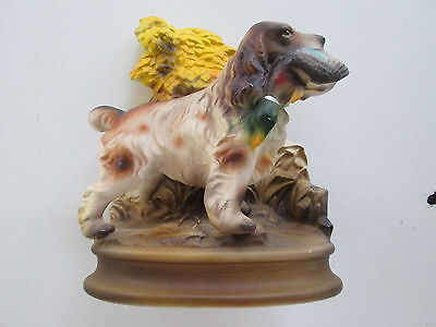 Vintage Figurine Of Water Spaniel Holding Duck