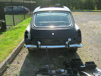 mgb gt chrome bumpers spares or restore many new parts much work done canDeliver