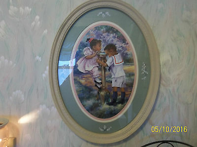 Beautiful Oval framed Print of African American Boy & Girl with Water Fountain